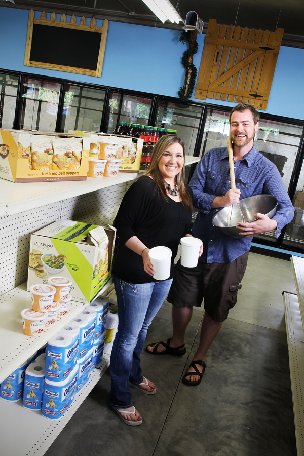Charly's Market owner Carolyn Miller and deli manager Drew Kaiser. The new market is at 225 E. Madison St.