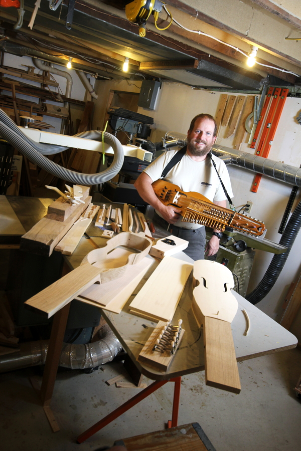 "Earl Holzman holds one of his handmade ""nyckelharpas,"" a 16-string instrument dating back to the late 1600s."