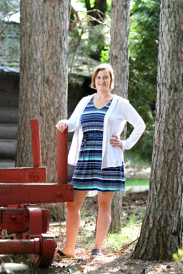 LOGGING ON. Author Caroline Akervik poses at the Paul Bunyan Logging Camp Museum in Carson Park.