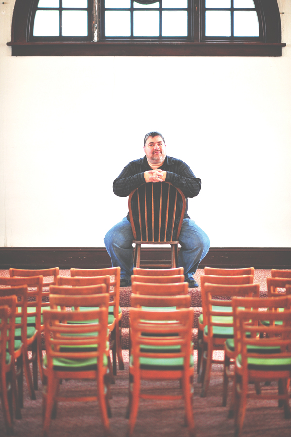 FINDING AN AUDIENCE. Red Cedar Youth Stage director Blaine Halverson in the theater group's new performance space above The Acoustic Café in Menomonie.