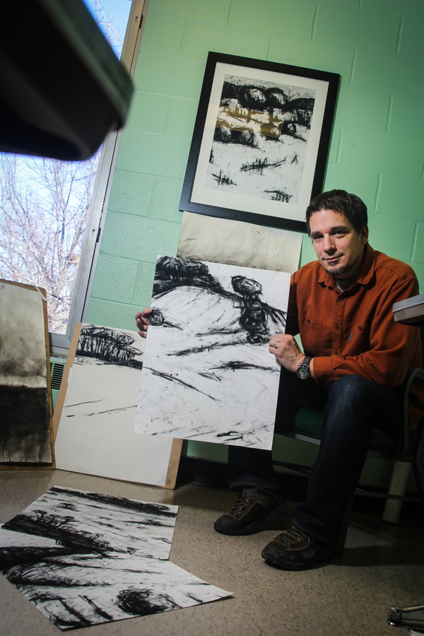 COAL PLUS SOUL. Artist David Brock displays some of his charcoal drawings in his office at UW-Eau Claire. His work will be on display at the Volume One Gallery March 6-April 24.